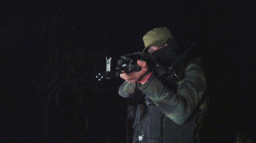 PHOTO: A member of the Sinaloa cartel shows off his weaponry.