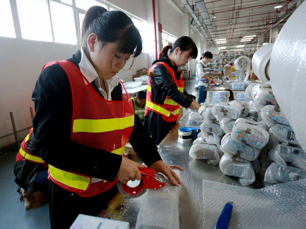 PHOTO: Staff members of a cross-border e-commerce company package products in Ningbo, China, Nov. 8, 2017.
