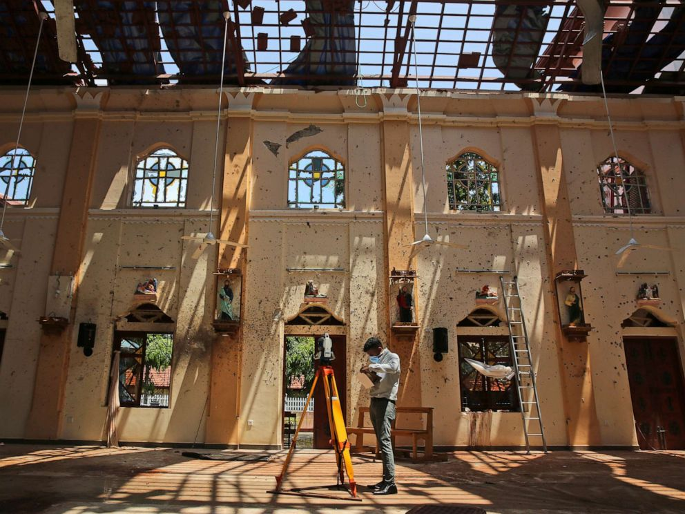 PHOTO: Sunlight steams in from gaping holes, as a surveyor works at St. Sebastians Church, where a suicide bomber blew himself up on Easter Sunday in Negombo, north of Colombo, Sri Lanka, April 25, 2019.
