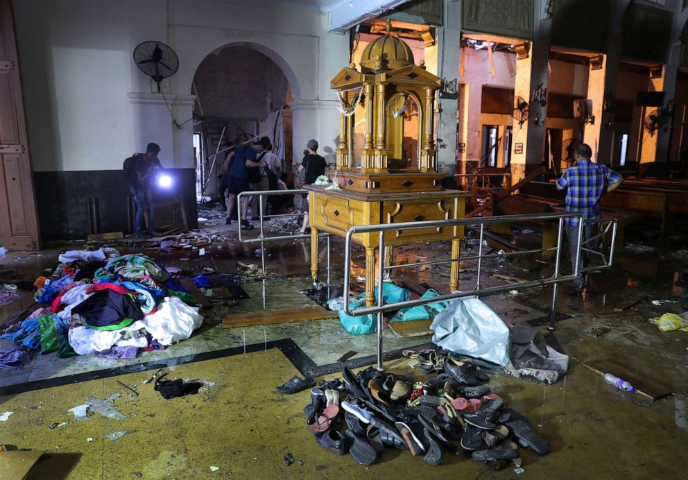 PHOTO: Shoes and other belongings left by panicked worshippers are seen stacked up inside St. Anthonys Church in Colombo, Sri Lanka, Friday, April 26, 2019.