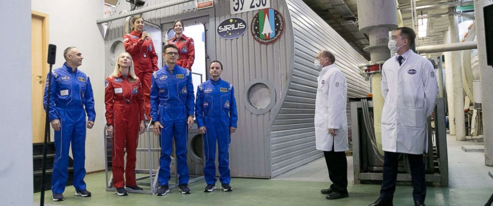 PHOTO: The SIRIUS-19 participants stand next to the habitat at Moscows Institute of Biomedical Problems where they will spend the next 4 months locked inside.