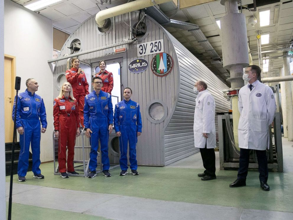 PHOTO: Participants in SIRIUS-19 stand near the habitat at the Institute of Biomedical Problems in Moscow, where they will spend the next 4 months locked inside.
