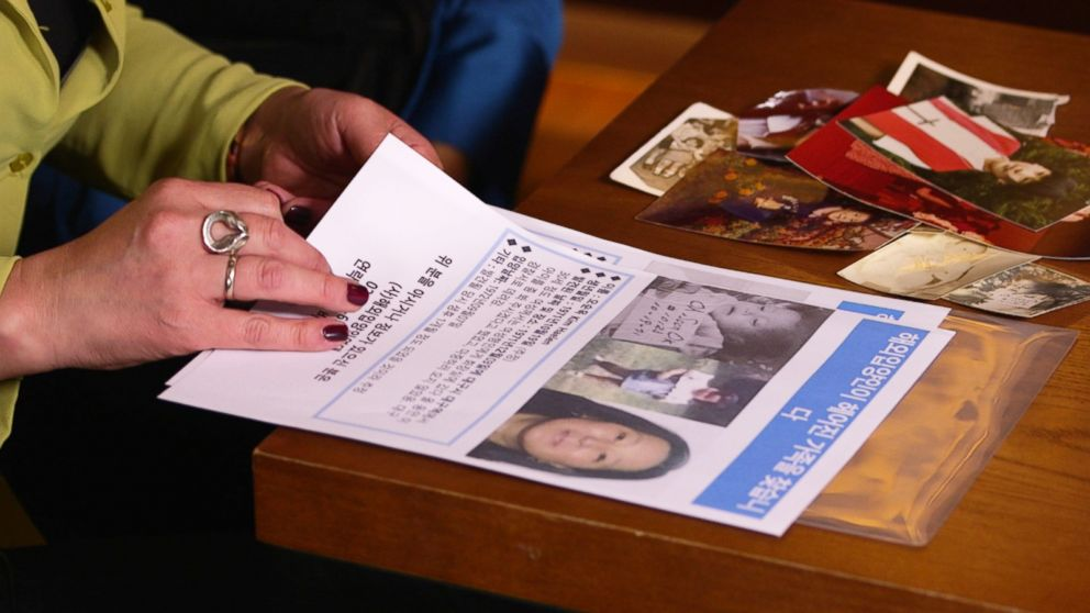 PHOTO: Christine Pennell and Kim Haelen distributed flyers in Daegu, South Korea hoping to find trace of their biological parents.