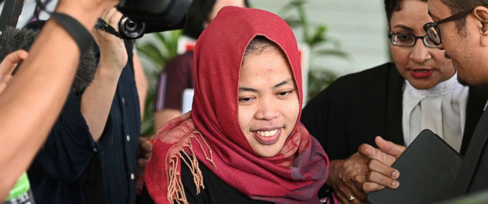 PHOTO: Indonesian national Siti Aisyah smiles while leaving the Shah Alam High Court, outside Kuala Lumpur, on March 11, 2019, after her trial for her alleged role in the assassination of Kim Jong Nam, the half-brother of North Korean leader Kim Jong Un.