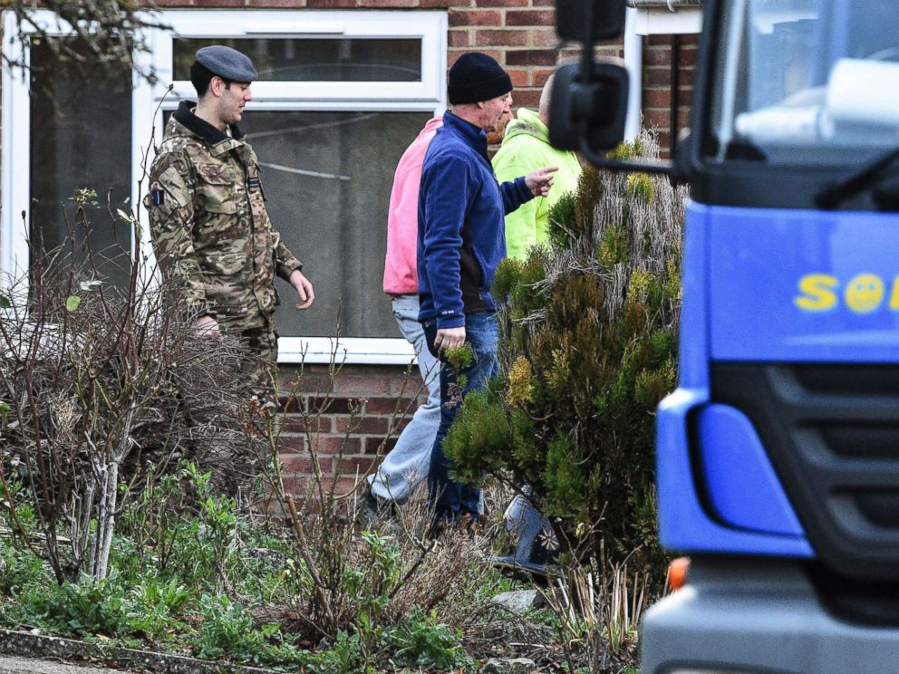 PHOTO: Contractors and military personnel seen outside the home of former Russian spy Sergei Skripal in Salisbury, England, as scaffolding is delivered, Jan. 8, 2019.