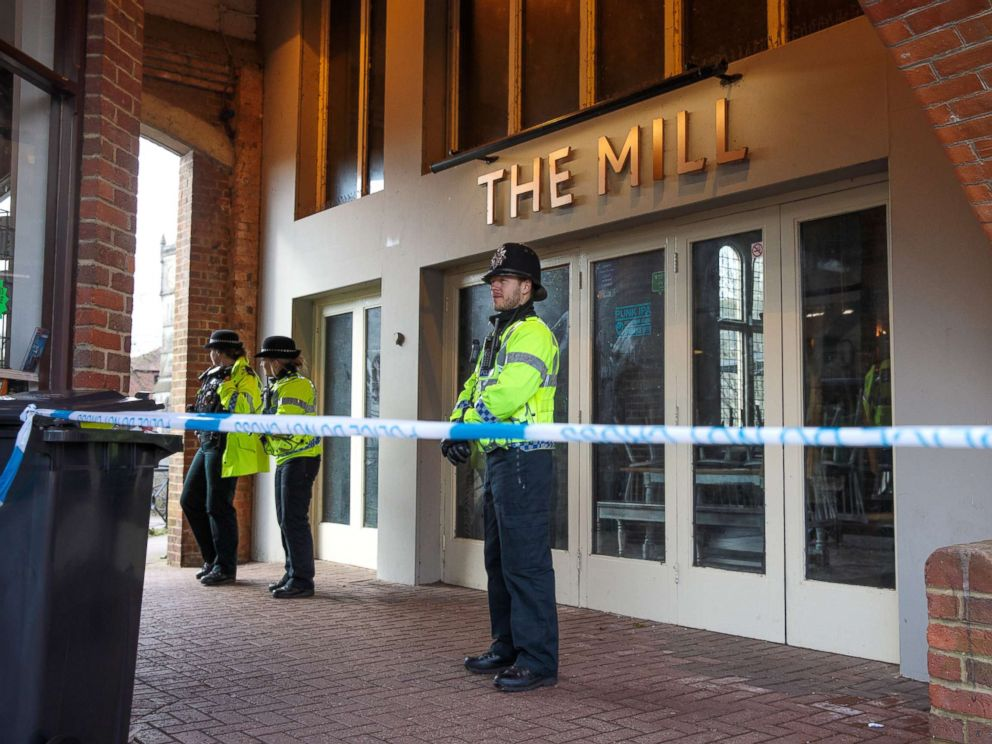 PHOTO: Police officers stand by the cordon outside The Mill pub as investigations continue into the poisoning of Sergei Skripal, March 13, 2018 in Salisbury, England.