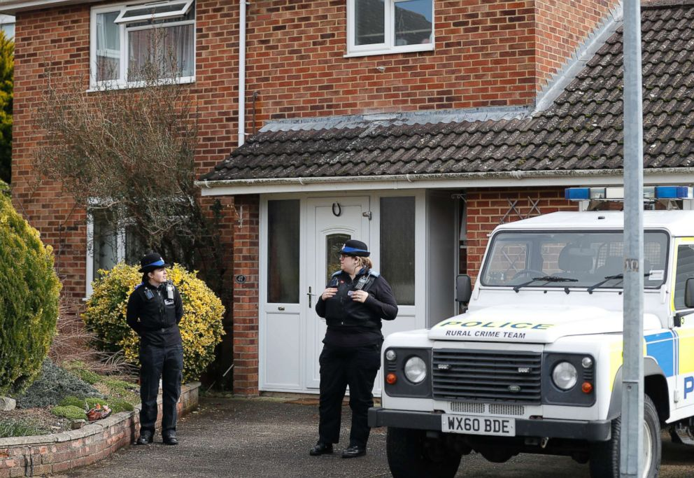 PHOTO: Police officers stand outside the house of former Russian double agent Sergei Skripal in Salisbury, England, March 6, 2018. British police believe Skripal his daughter first came into contact with a military-grade nerve agent at their front door.