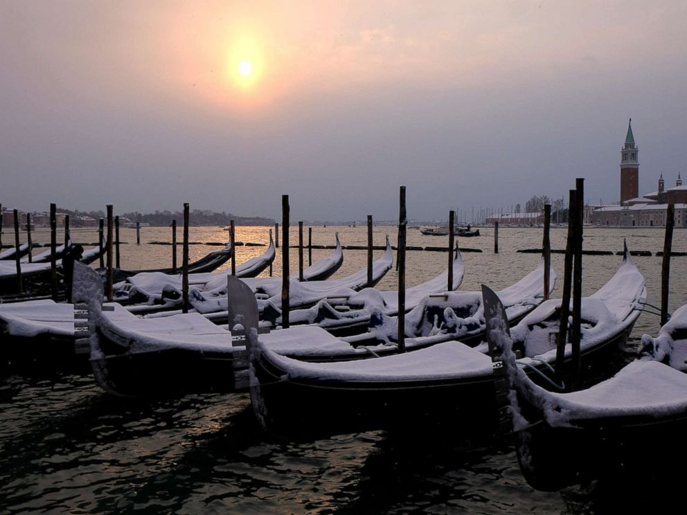 PHOTO: Snow covered gondolas are seen near St.Mark square in Venice lagoon, Italy, Feb. 28, 2018.