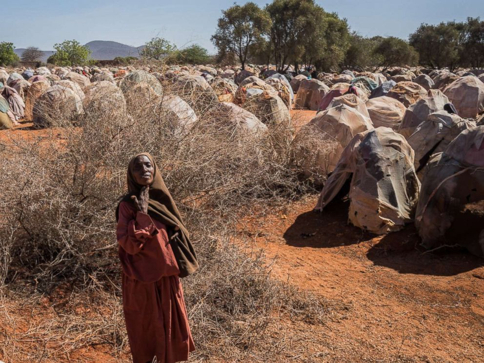 PHOTO: An elderly woman begs for food at a camp for the internally displaced on the outskirts of Dinsor, Somalia, March 8, 2017. The country is on the brink of a famine, just six years after another famine led to the loss of a quarter of a million lives.