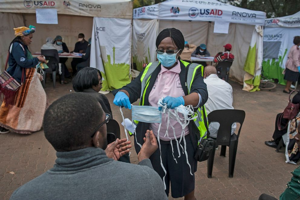 A nurse gives a mask to a citizen before the COVID-19 testing in Johannesburg, South Africa, April 7, 2020.Shiraaz/Xinhua News Agency via Getty Images