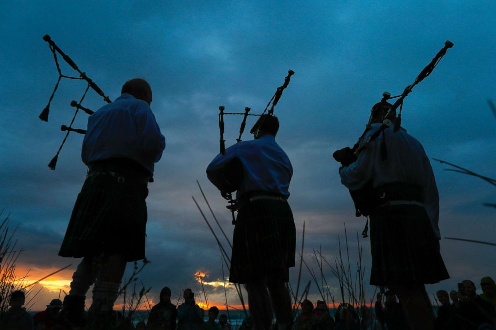 PHOTO: Men play bag-pipes during New Years eve celebrations at sunset on Scarborough beach in Cape Town, South Africa, Dec. 31, 2017.