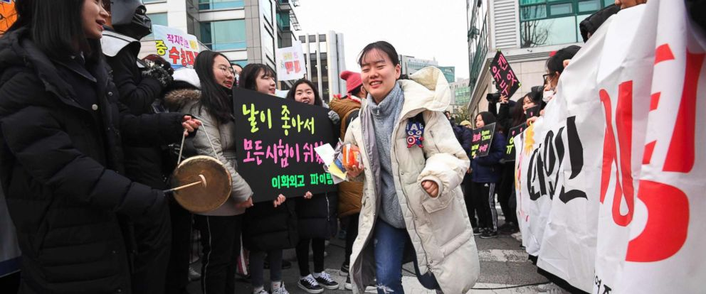 PHOTO: High school students cheer their seniors taking the annual College Scholastic Ability Test, a standardized exam for college entrance, at a high school in Seoul, South Korea on Nov. 23, 2017.