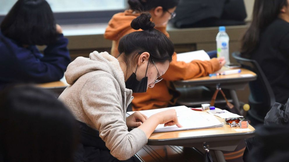 Students prepare to take the annual College Scholastic Ability Test, a standardized exam for college entrance, at a high school in Seoul on Nov. 23, 2017.