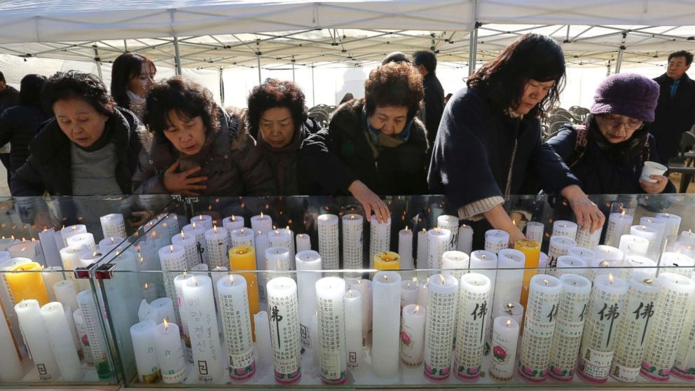 Women place candles during a special service to wish for their family members' success in the college entrance exams at the Jogye temple in Seoul, South Korea, Nov. 23, 2017.