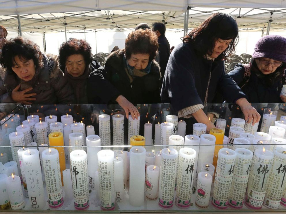 PHOTO: Women place candles during a special service to wish for their family members success in the college entrance exams at the Jogye temple in Seoul, South Korea, Nov. 23, 2017.