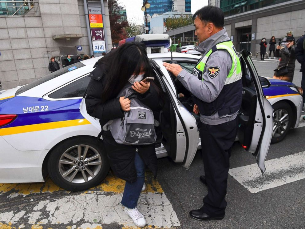 PHOTO: A student gets out of a police car as she arrives to sit the annual College Scholastic Ability Test, a standardized exam for college entrance, at a high school in Seoul on Nov. 23, 2017.