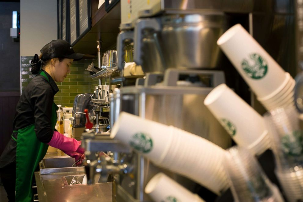 PHOTO: A barista washes at a sink inside a Starbucks Coffee Korea Co. store in Gimpo, South Korea, March 7, 2014.