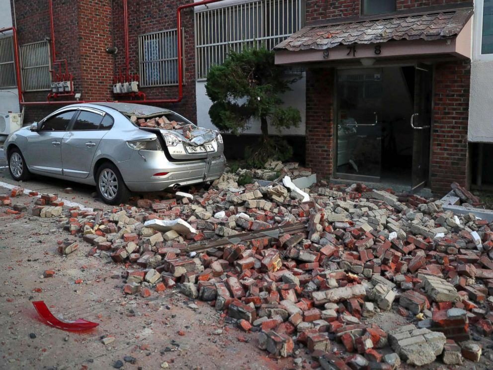 PHOTO: A car damaged by falling bricks after a 5.4-magnitude earthquake is seen in the southeastern port city of Pohang, Nov. 15, 2017.