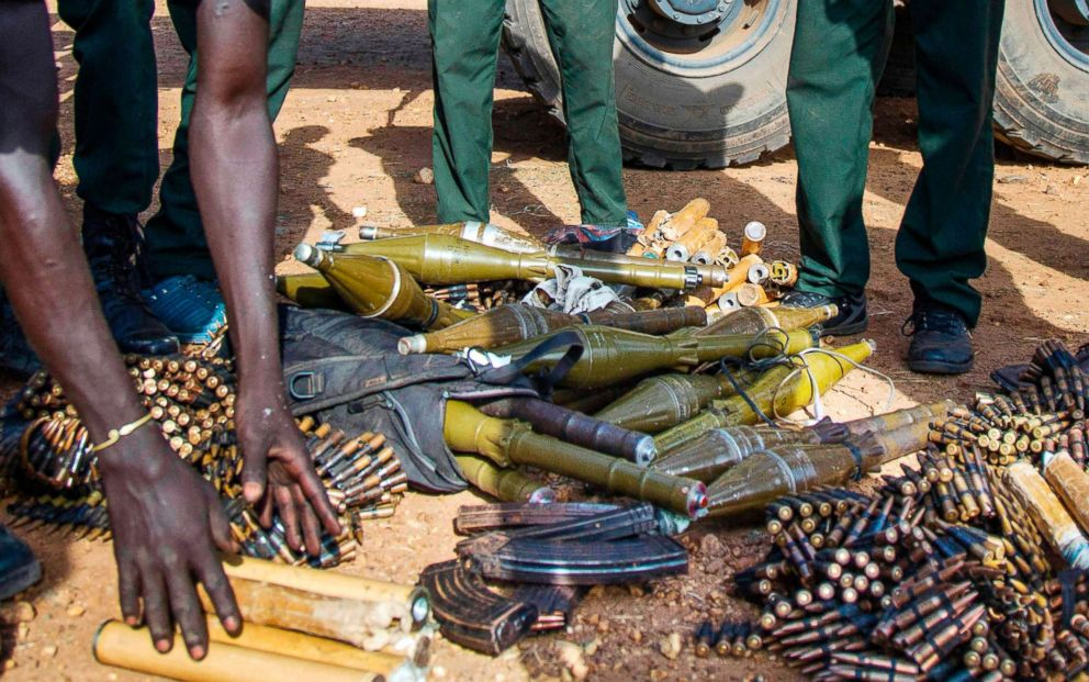 PHOTO: In this file photo taken on April 25, 2016, rebel troops of the Sudan Peoples Liberation Army in Opposition (SPLA-IO) unload their weapons at their military site in Juba, South Sudan.