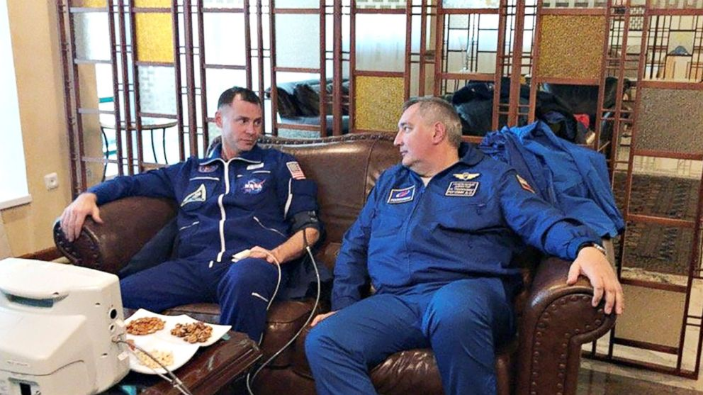 U.S. astronaut Nick Hague, left, speaks with head of the Russian space agency Roscosmos Dmitry Rogozin, after the Soyuz MS-10 Hague was in made an emergency landing following a failure of its booster rockets, in Zhezkazgan, Kazakhstan on Oct. 11, 2018.