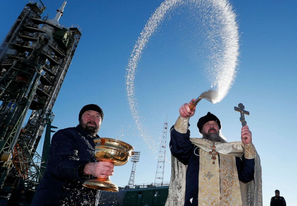 PHOTO: An Orthodox priest conducts a blessing in front of the Soyuz MS-11 spacecraft set on the launchpad ahead of its upcoming launch, at the Baikonur Cosmodrome in Kazakhstan, Dec. 2, 2018.