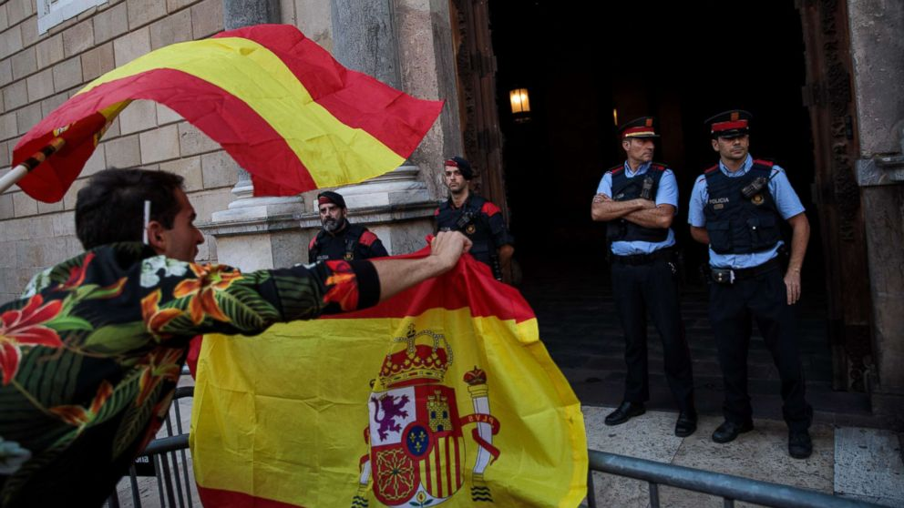 Nationalist supporters gesture at police outside the Catalan Government building, the Palau de la Generalitat following a pro-unity protest on Oct. 29, 2017 in Barcelona, Spain.