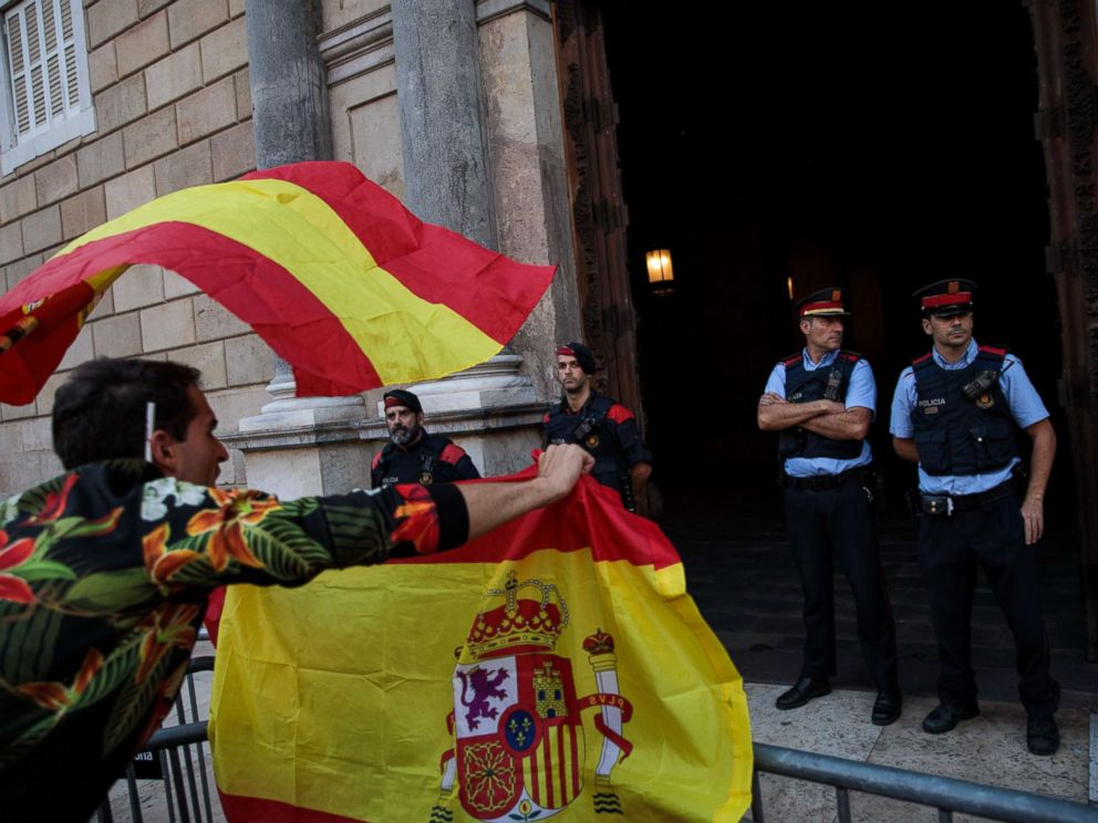 PHOTO: Nationalist supporters gesture at police outside the Catalan Government building, the Palau de la Generalitat following a pro-unity protest on Oct. 29, 2017 in Barcelona, Spain.