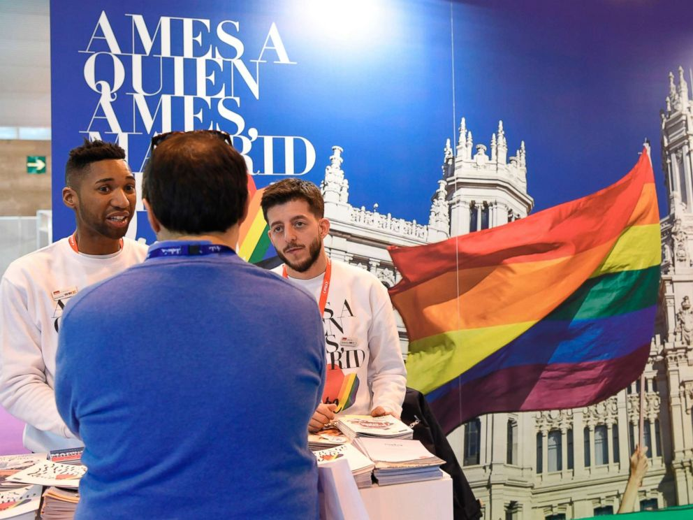 PHOTO: Men stand at the Madrid LGBT stand during the International Tourism Fair in Madrid on Jan. 17, 2018.
