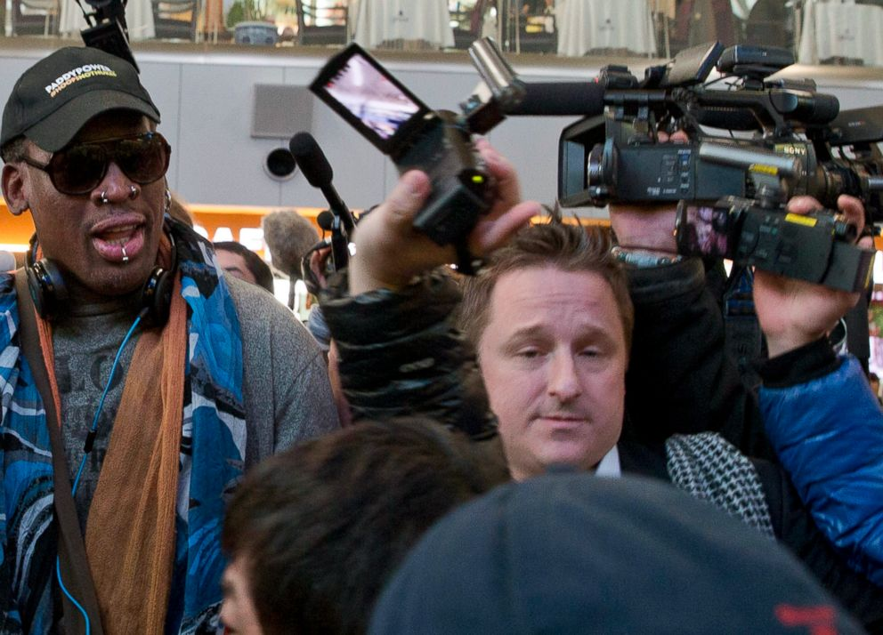 In this Dec. 19, 2013, file photo, Michael Spavor, center, an entrepreneur, is seen with former NBA star Dennis Rodman, left, on the arrival at the capital airport for a flight to North Korea, in Beijing, China.