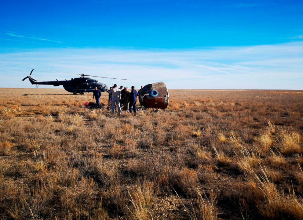 PHOTO: In this photo provided by Russian Defense Ministry Press Service, the rescue team gather next to the Soyuz MS-10 space capsule after it made an emergency landing in a field 280 miles northeast of Baikonur, Kazakhstan, Oct. 11, 2018.