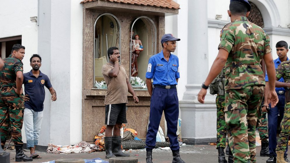People gather outside St. Anthony's Shrine, where a blast happened in Colombo, Sri Lanka, Sunday, April 21, 2019. A Sri Lanka hospital spokesman says several blasts on Easter Sunday have killed dozens of people.