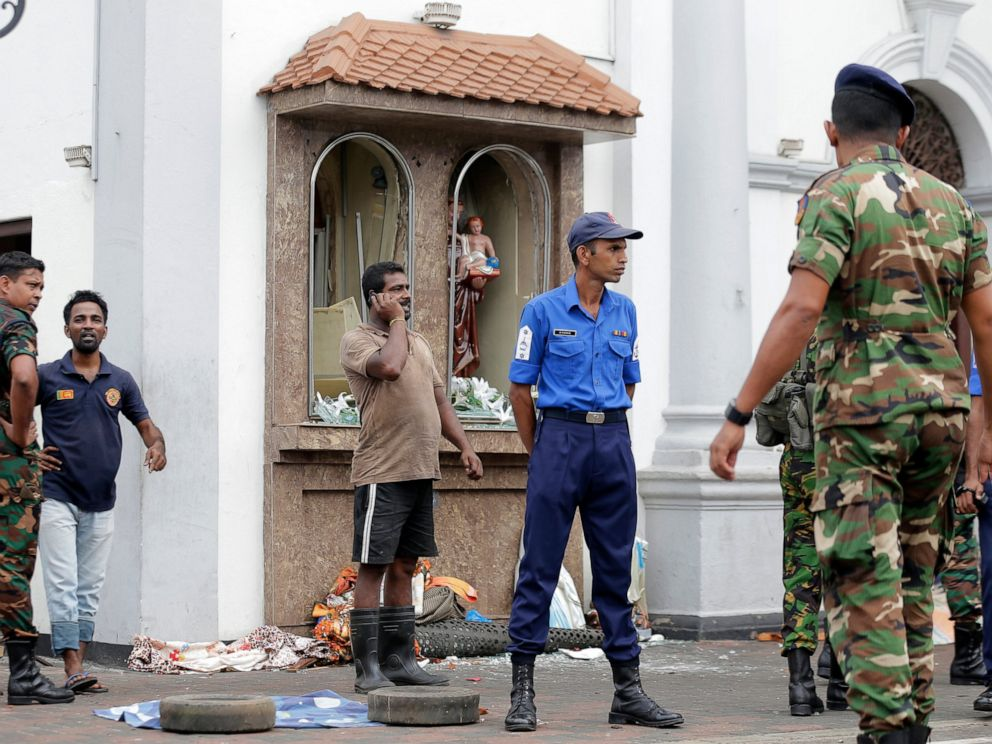 PHOTO: People gather outside St. Anthonys Shrine where a blast happened, in Colombo, Sri Lanka, Sunday, April 21, 2019. A Sri Lanka hospital spokesman says several blasts on Easter Sunday have killed dozens of people.