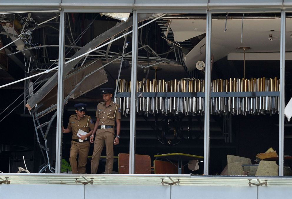 Sri Lankan police stand at the site of an explosion in a restaurant area of the luxury Shangri-La Hotel in Colombo, Sri Lanka, April 21, 2019.