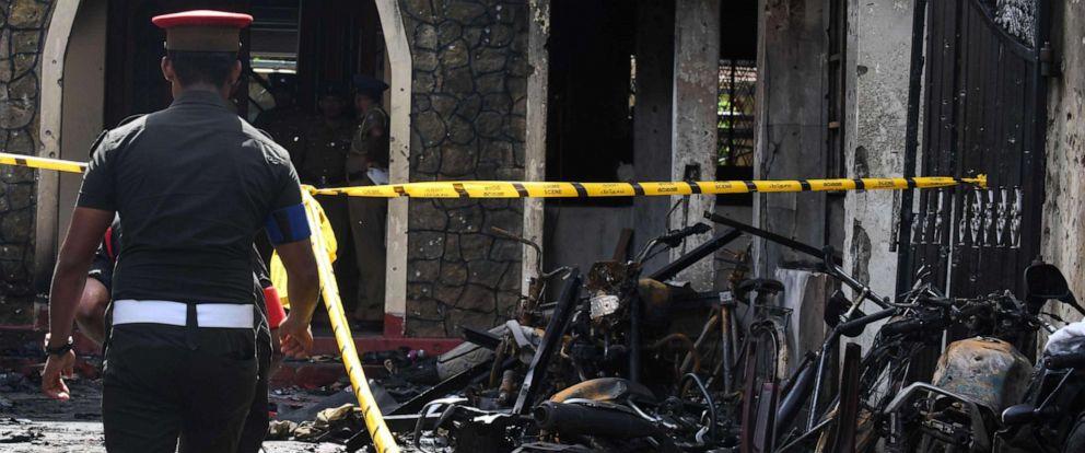 PHOTO: Sri Lankan security personnel walk past debris outside Zion Church following an explosion in Batticaloa, Sri Lanka, April 21, 2019.
