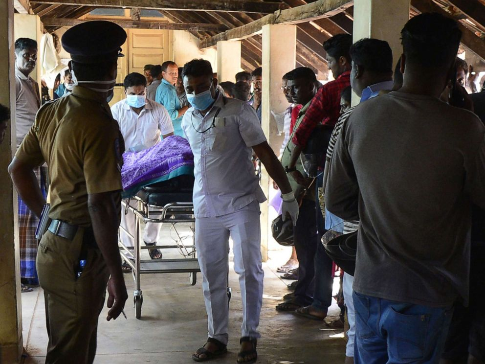 PHOTO: Sri Lankan hospital workers transport a body on a trolley at a hospital morgue following an explosion at a church in Batticaloa, Sri Lanka, April 21, 2019.