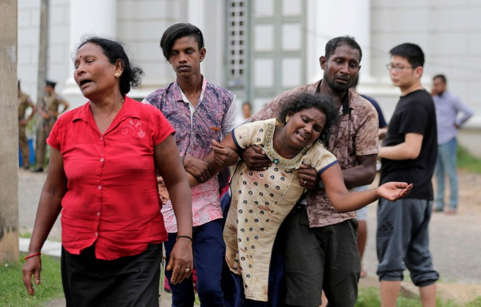 Relatives of a blast victim grieve outside a morgue in Colombo, Sri Lanka, April 21, 2019.