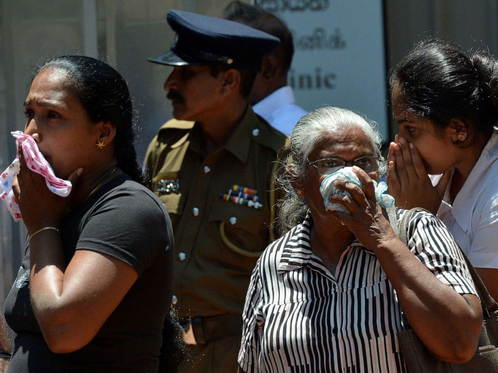 PHOTO: Sri Lankan woman looks into a container where bodies of bomb blast victims are kept at a hospital in Negombo on April 22, 2019, a day after a nearby church was hit in a series of explosions targeting churches and luxury hotels in Sri Lanka.