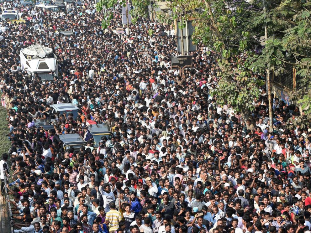PHOTO: Crowds gather behind the funeral procession of Indian Bollywood actress Sridevi Kapoor in Mumbai, India, Feb 28, 2018.
