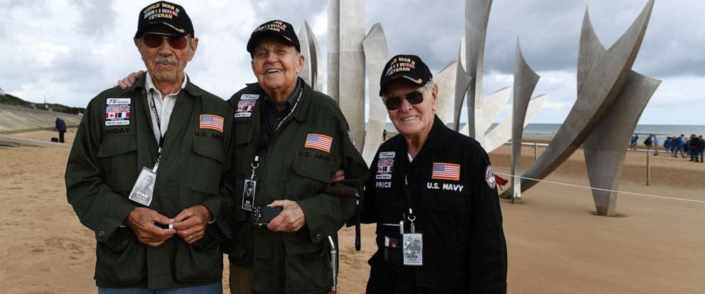 PHOTO: US WWII veterans (from left) Stan Friday, from Pennsburg, Pa., KT Robbins, from Olive Branch, Miss., and Buck Price from Tarboro, N.C., stand on Omaha Beach in Normandy, France, on June 5, 2019.