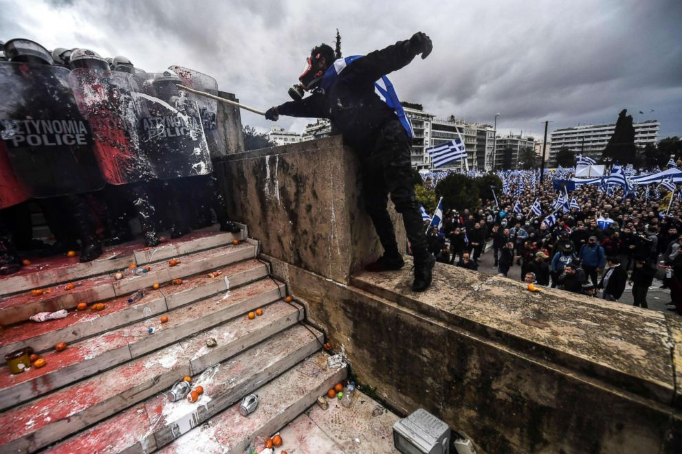 PHOTO: A demonstrator clashes with riot police in front of the Greek Parliament in Athens, Jan. 20, 2019, during a protest against the agreement with Skopje to rename neighboring country Macedonia as the Republic of North Macedonia.