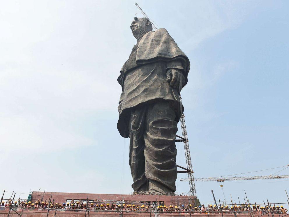 PHOTO: Workers pose at the base of the worlds tallest statue dedicated to Indian independence leader Sardar Vallabhbhai Patel, overlooking the Sardar Sarovar Dam near Vadodara in Indias western Gujarat state, Oct. 18, 2018.