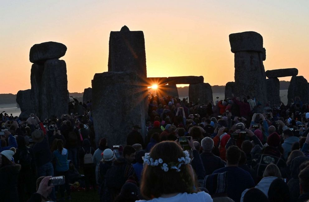 PHOTO: Revelers watch the sun rise at Stonehenge, near Amesbury, England, June 21, 2019, as they celebrate the summer solstice.