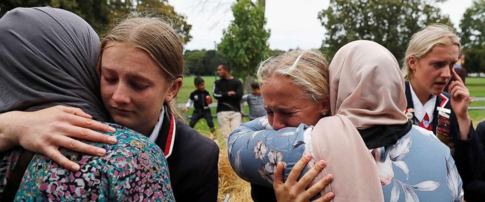 PHOTO: High school students from a Christian school give hugs to Muslims waiting for news of their relatives at a community center, in Christchurch, New Zealand, March 18, 2019.