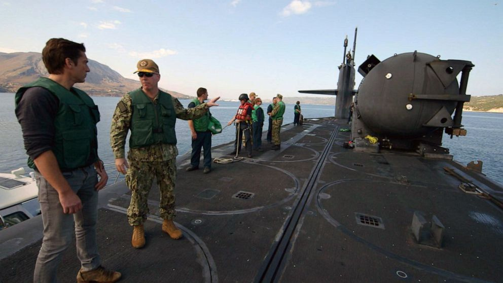 PHOTO: ABC News anchor David Muir speaks with Rear Adm. William Houston on top of U.S. Navy guided missile submarine USS Florida.