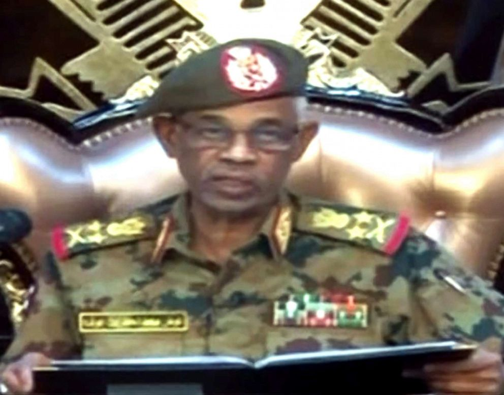 A grab from a live broadcast on Sudan TV shows Sudanese Defence Minister Ahmed Awad Ibnouf delivering a speech in Khartoum, announcing that President Omar al-Bashir was removed from power on April 11, 2019.