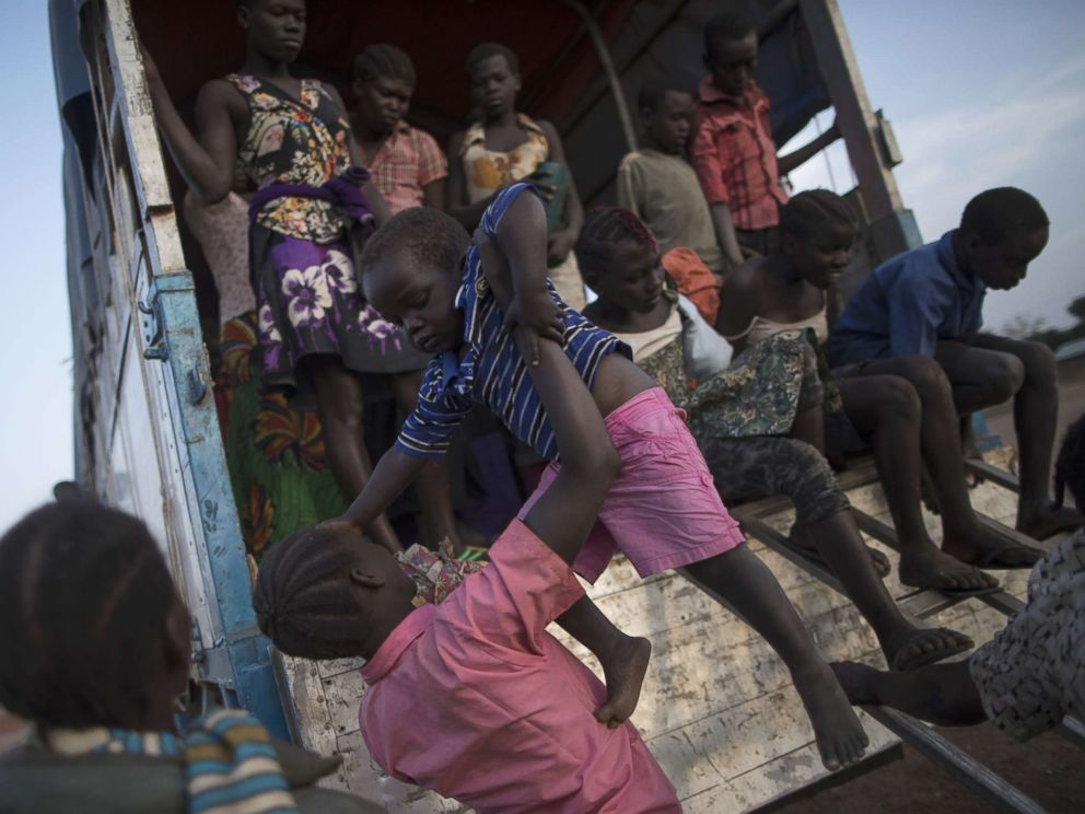 PHOTO: South Sudanese refugee families disembark a bus at the Kuluba Collection Point after being brought from the border, Feb. 24, 2017 in Kuluba, Uganda.