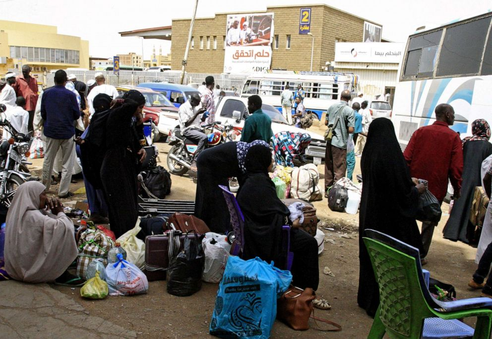 PHOTO: Passengers wait for their shuttle at the main bus station in Khartoum, linking the Sudanese capital with various parts of the country, June 12, 2019.