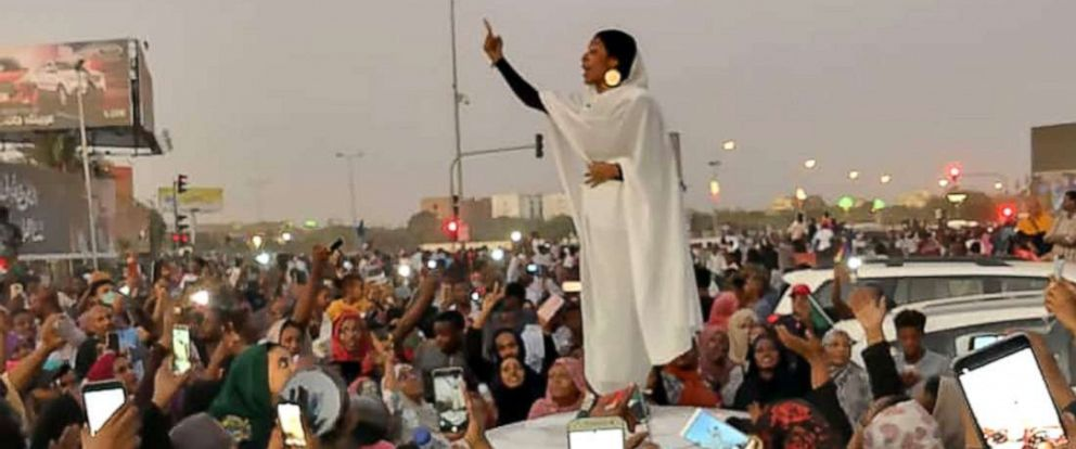 PHOTO: A Sudanese woman leads a chant during a protest demanding Sudanese President Omar Al-Bashir to step down along a bridge in Khartoum, Sudan, April 8, 2019, in an image taken from a social media video.