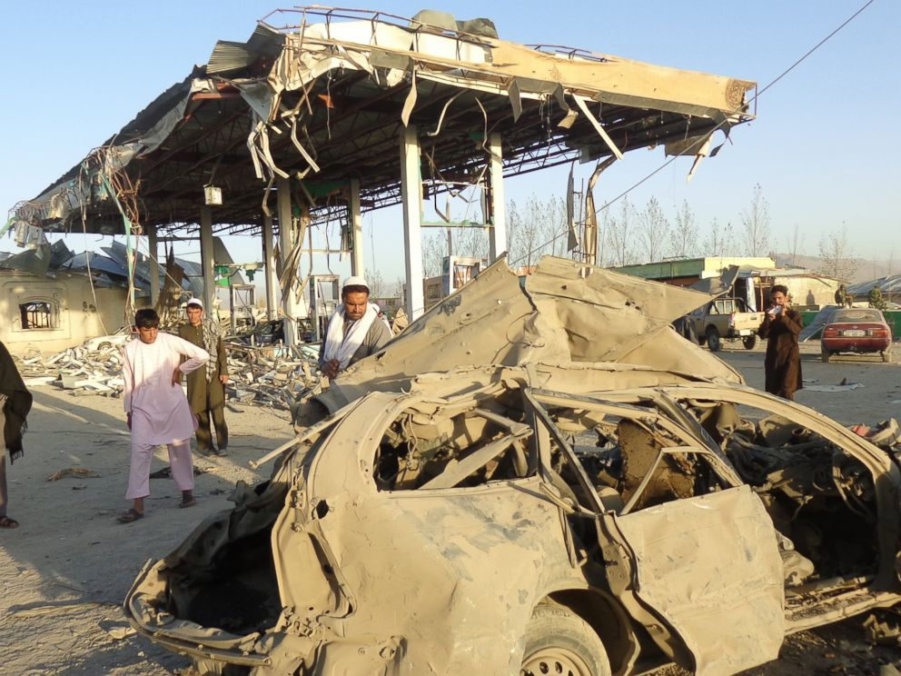 PHOTO: People survey the destruction caused at the scene of a suicide bomb attack that targeted a Police post, in Paktia, Afghanistan, Oct. 17, 2017.