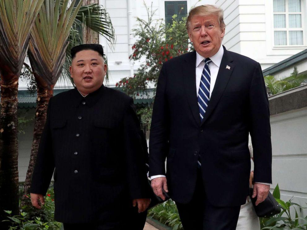PHOTO: North Korean leader Kim Jong Un and President Donald Trump walk in the garden of the Metropole hotel during the second North Korea-U.S. summit in Hanoi, Vietnam, Feb. 28, 2019.